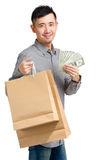 Man with shopping bag and spread of money Royalty Free Stock Images