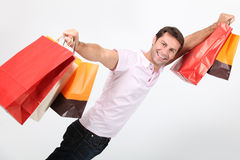 Man with shopping bags. A young man with shopping bags stock images