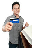 Man with shopping bags and credit card Stock Photography