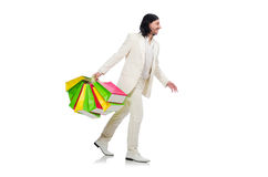 Man with shopping bags isolated on white Royalty Free Stock Images