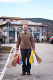 Man with shopping bags Royalty Free Stock Images