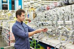 Man shopping for bathroom equipment Stock Images