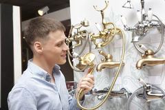 Man shopping for bathroom equipment in hardware store Stock Photography