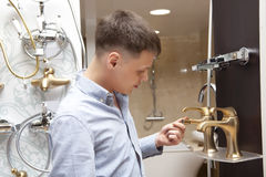 Man shopping for bathroom equipment in store Stock Photos