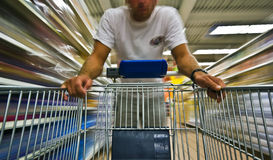 Man shopping blur. A young man is shopping a hypermarket Stock Photo