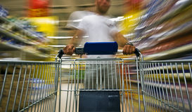 Man shopping blur. A young man is shopping a hypermarket Stock Image