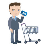 Man with a shopping cart and credit card Stock Photo