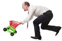 Man with shopping cart Royalty Free Stock Photography