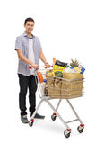 Man with a shopping cart and looking at the camera Stock Photo