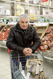 Man with shopping cart Stock Photos