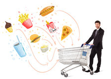 Man with shopping cart with toxic junk food Stock Photo