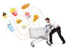 Man with shopping cart with toxic junk food Royalty Free Stock Image