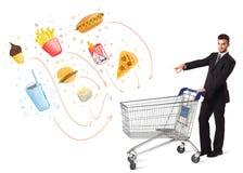 Man with shopping cart with toxic junk food Stock Photos