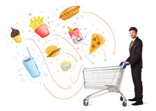 Man with shopping cart with toxic junk food Stock Image