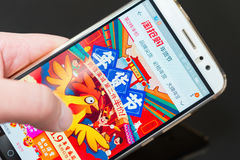 Man shopping for Chinese new year through a 4G mobile on taobao Stock Images