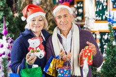 Man Shopping For Christmas With Woman In Store Stock Photo