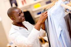 Man shopping for clothes Stock Image