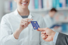 Man shopping with a credit card stock photos