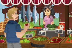Man Shopping in a farmers market. A vector illustration of man shopping in an outdoor farmers market Stock Image