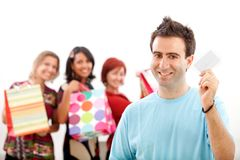 Man with shopping girls Stock Photography