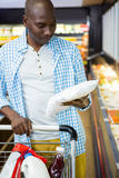 Man shopping in grocery section Stock Photos