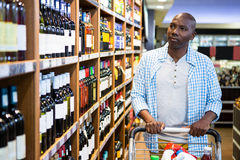Man shopping in grocery section. At supermarket Royalty Free Stock Photos