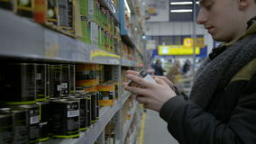 Man shopping in grocery section of supermarket