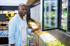 Man shopping in grocery section at supermarket Stock Photos