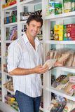 Man Shopping In Grocery Store. Portrait of happy mid adult man shopping in grocery store stock image