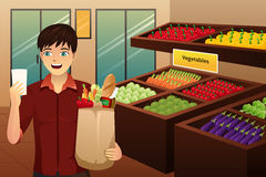 Man shopping at the grocery. A vector illustration of man shopping at the grocery vector illustration