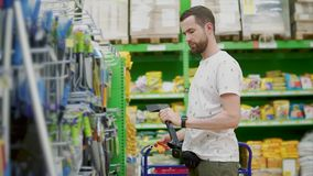 A man shopping in a hardware store. stock video footage