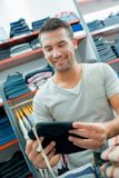 Man shopping for hat Royalty Free Stock Photo