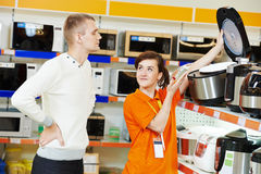 Man shopping at home appliance supermarket Stock Images