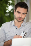 Man shopping on the internet Royalty Free Stock Images