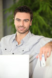 Man shopping on-line Royalty Free Stock Photos