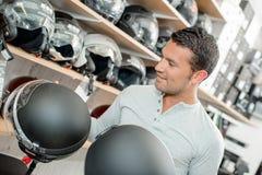 Man shopping for motorbike helmet Stock Photos