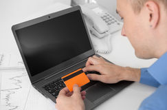 Man shopping online. With credit card and computer. Internet Shopping Stock Image
