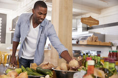 Man Shopping For Organic Produce In Delicatessen Royalty Free Stock Photography