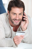 Man shopping over the telephone Royalty Free Stock Photography