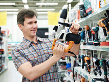 Man shopping for perforator in hardware store. Close-up Royalty Free Stock Photos