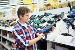 Man shopping for perforator in hardware store Stock Image
