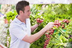 Man shopping in produce department. Man shopping in produce section of supermarket Stock Photography