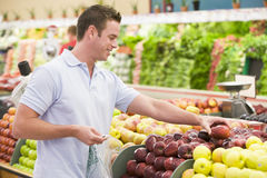 Man shopping in produce section. Man shopping in produce setion of supermarket Royalty Free Stock Image