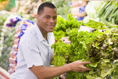 Man shopping in produce section. Of supermarket Royalty Free Stock Image