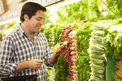 Man Shopping For Produce In Supermarket Royalty Free Stock Images
