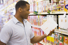 Man shopping in supermarket Stock Photo