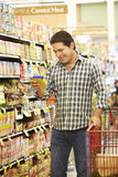 Man shopping in supermarket Royalty Free Stock Photos