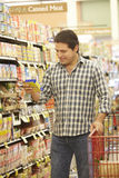 Man shopping in supermarket Royalty Free Stock Images