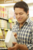 Man shopping in supermarket Stock Photography