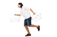 Man shopping with supermarket basket cart Stock Photos